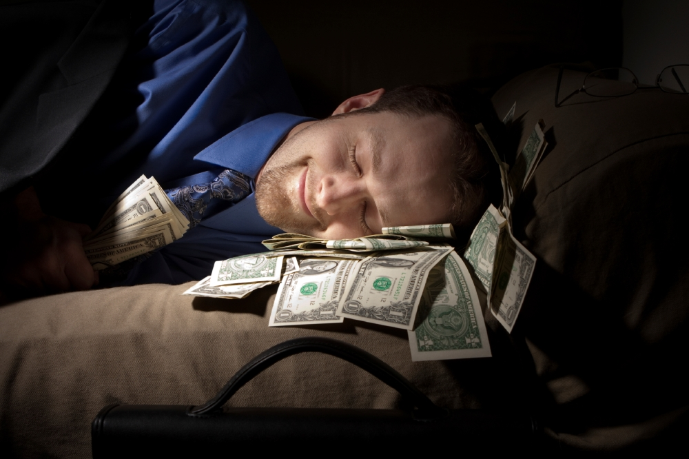 mansleeping-with-money.jpg